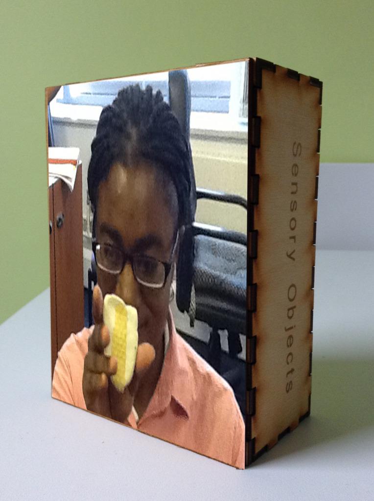 Adjoa with her sensory artwork on box